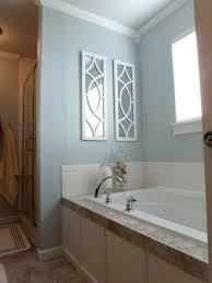 gray wall paitn glass window panel wall lamp washbasin stainless