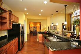 oak kitchen cabinets yellow walls yellow walls and gorgeous marble countertops yellow