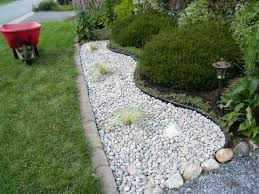 landscaping with river rock installation front yard landscaping