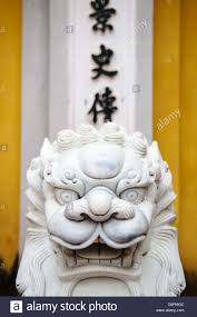 marble lions ornately carved white marble lions guard the entrance to a gate at