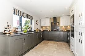 grey kitchen cupboards with black worktop savoy shaker painted in light grey and lava with silestone