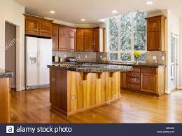 Range In Island Kitchen Modern Daylight Kitchen With Solid Red Oak Flooring Cherry Wood