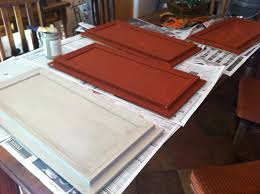 Putting Trim On Cabinets by Kym Starts Her Kitchen Cabinets Using Caromal Paprika And Putty