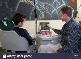 Orthodontist Job Male Dentist Orthodontist Showing Young Male Patient His X Rays