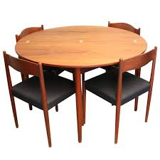 round teak folding dining table and chairs by poul volther for