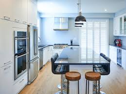 blue kitchen cabinets toronto snow white kitchen with black countertop in toronto house