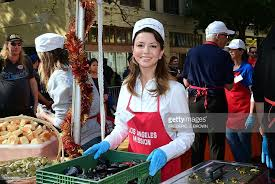masiela lusha helps out as a volunteer at the los angeles
