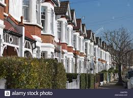 row of terraced victorian houses with bay windows in bedford park