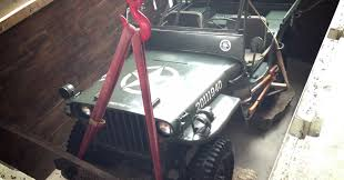 wwii jeep engine video canadian dealership buries wwii jeep in its foundation