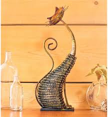 tabletop cat sculpture made of metal mesh wind weather
