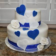 wedding cake royal blue royal blue hearts and white roses wedding cake box of macarons