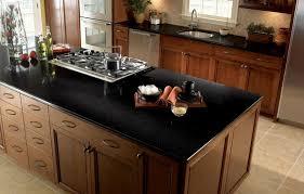 Interior Black Quartz Countertop Kitchen With White Wooden - Stainless steel cooktop backsplash
