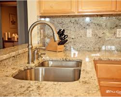 kitchen faucets for granite countertops colonial gold granite with maple cabinets search