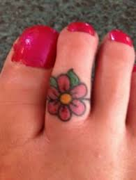 flower tattoo ring daisy flower tattoos toe ring tattoos ring tattoos and toe rings