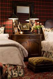 an english gentleman s guest bedroom features wool tartan plaid an english gentleman s guest bedroom features wool tartan plaid upholstered walls antique french iron headboards