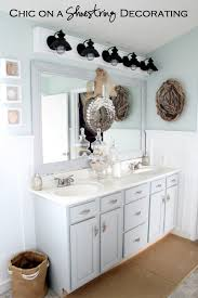 chic on a shoestring decorating how to build a bathroom light fixture