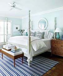 guest bedroom decor with turquiose wall and wooden nighstands and