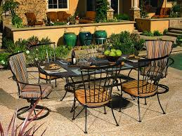 Iron Patio Table With Umbrella Hole by Beautiful Oval Wrought Iron Patio Table 21 For Lowes Patio Tables