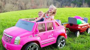 frozen power wheels sleigh driving barbie power wheels ride on car u0026 giant surprise egg hunt