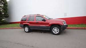 rose gold jeep cherokee 2004 jeep grand cherokee laredo 4x4 inferno red tinted pearl