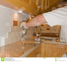 Installing Kitchen Tile Backsplash Ceramic Tile Installation On Kitchen Backsplash 12 Royalty Free