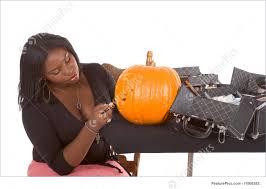 makeup artist halloween people black make up artist decorating halloween pumpkin stock