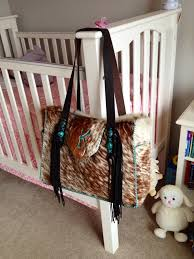 the buckaroo diaper tote customized with suede lined side pockets
