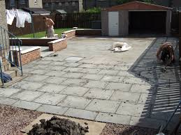 Pointing A Patio by Heavy 2x2 Slabs Just Pointing Them After Laying Them Plus The