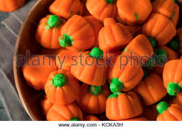 pumpkin candy corn candy corn and pumpkin background stock photo royalty