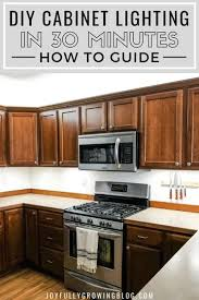 diy kitchen cabinets install how to add kitchen cabinet lighting in just 30 minutes