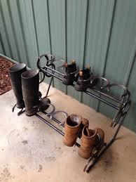 shoe rack made with horse shoes horseshoe art pinterest