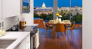 reap the full benefits of floor to ceiling windows apartments apartment kitchen and dining area with view of u s capitol dome in background