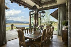 country dining room with indoor outdoor living by locati