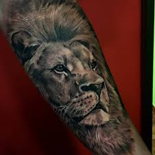 black and grey style lion tattoo on the forearm by sergio