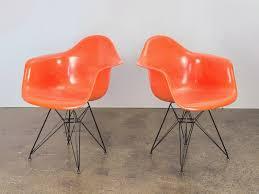 pair of orange eames armchair shells u2014 oam