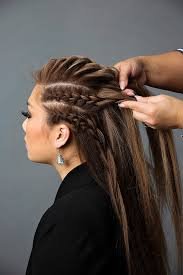 add the french braids on the sides to the french braid on top and