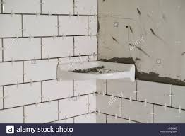 tub surround for a tall shower with white subways tiles set stock