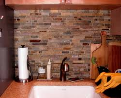 tumbled stone backsplash before and after cabinets painted