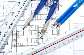 pencil and tools over a construction drawing of a house stock