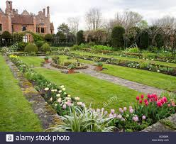 the sunken garden at chenies manor house in early spring with