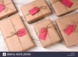 brown paper wrapping a of plain brown paper wrapped christmas presents on a white
