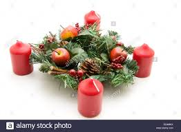 christmas flower arrangement with candles stock photo royalty