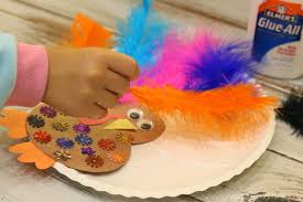 how to make turkey feathers paper plate feathered turkey craft at heart