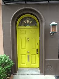 Door Design In India by Create A Sharp Contrast With Bright Green And Dark Gray Colors