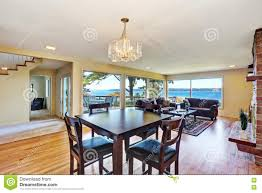 interior of nicely furnished living and dining room stock photo