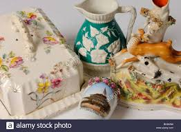 a collection of ornaments including a cheese dish jug