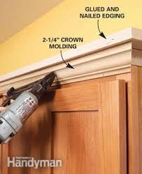 crown molding for kitchen cabinet tops how to add shelves above kitchen cabinets moldings shelves and