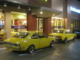mitsubishi toyota toyota corolla 1971 and mitsubishi lancer 1979 ke 25 and a