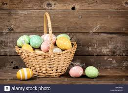 wooden easter baskets easter basket filled with painted eggs a rustic wooden