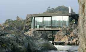 tucked away norwegian island house on stilts is only accessible by